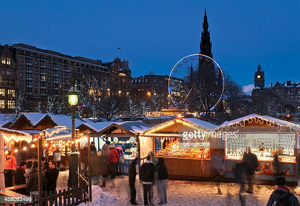 christmas market in central edinburgh - christmas scenes stock photos and pictures