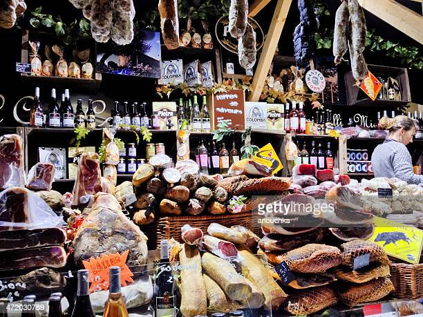 christmas market in paris. sausages, cheese, foie gras. - french food stock pictures, royalty-free photos & images