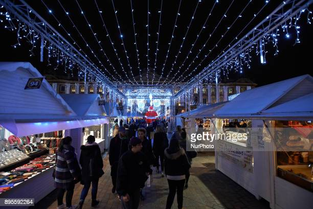 A Christmas market is placed on the main square of Toulouse the Capitole People come to buy a hot wine or find some gifts On December 19th 2017 in...