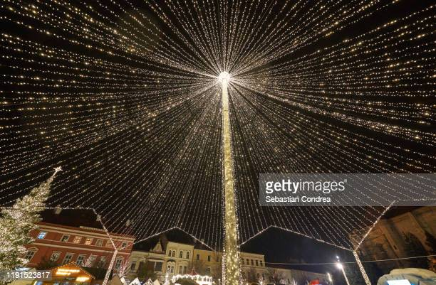 christmas market web of lights at fair, covering all stalls, in cluj-napoca, romania at national day - national landmark stock pictures, royalty-free photos & images