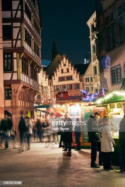 Christmas market with crowds in Frankfurt illuminated at night