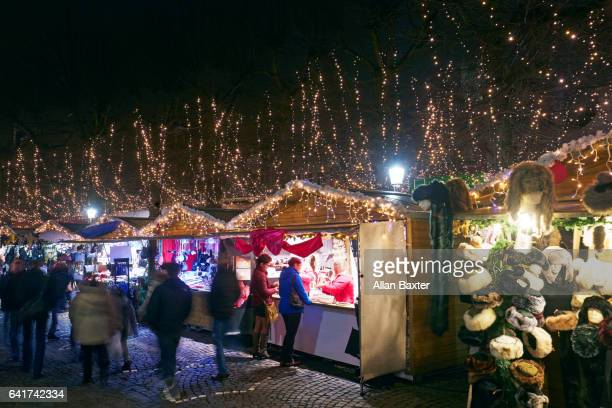 Christmas Market with shoppers in Bruges at night