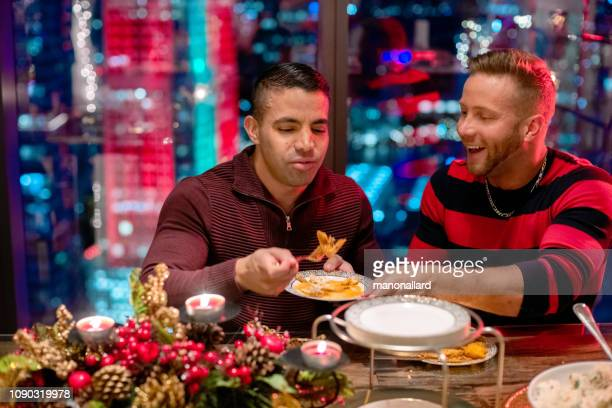 christmas meal with multi-ethnic gays - florida christmas stock pictures, royalty-free photos & images