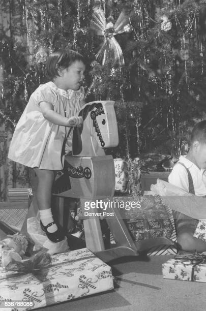 Christmas morn at the home of Mr and Mrs Clayton Dorsey Knowles finds their two children 1 1/2yearold Dorritt and 3 1/2yearold David trying out the...