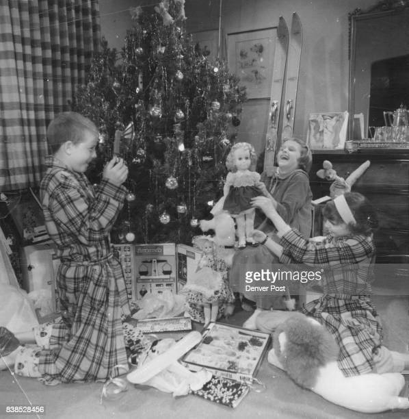 Christmas Morning Brings Gifts Glee This scene of children gathered under the tree to open their presents was being repeated at homes across the...