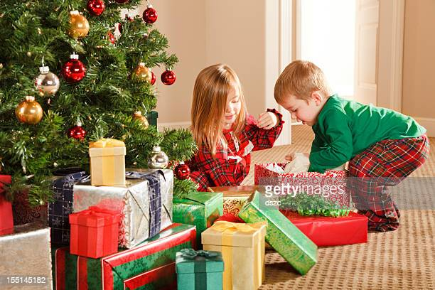 Christmas Morning Excitement, Little Boy and Girl Siblings Opening Gifts