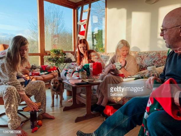 christmas morning traditions - 12 17 months stock pictures, royalty-free photos & images