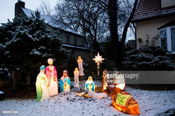 Christmas Nativity scene covered with snow is seen at a house on Christmas day on December 25 2017 in Riverdale neighborhood of the Bronx borough of...