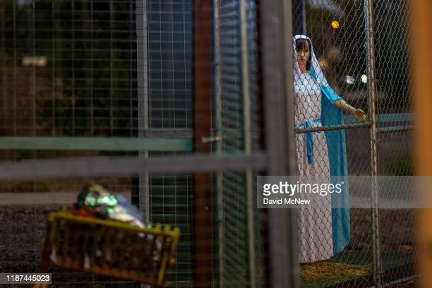 Christmas nativity scene depicts Jesus, Mary, and Joseph separated and caged, as asylum seekers detained by U.S. Immigration and Customs Enforcement,...
