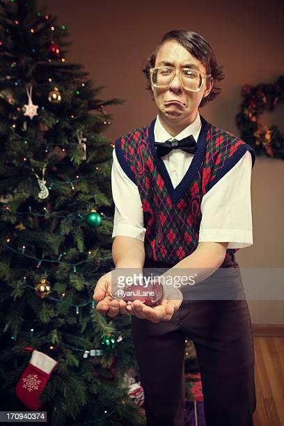 Christmas Nerd Child with Broken Tree Decoration