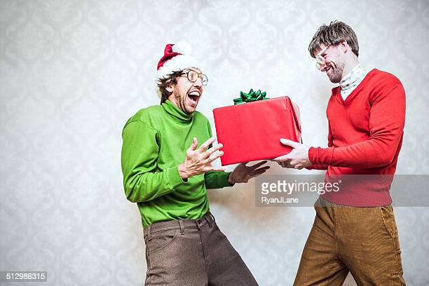 christmas nerd giving present - ugly wallpaper stock photos and pictures