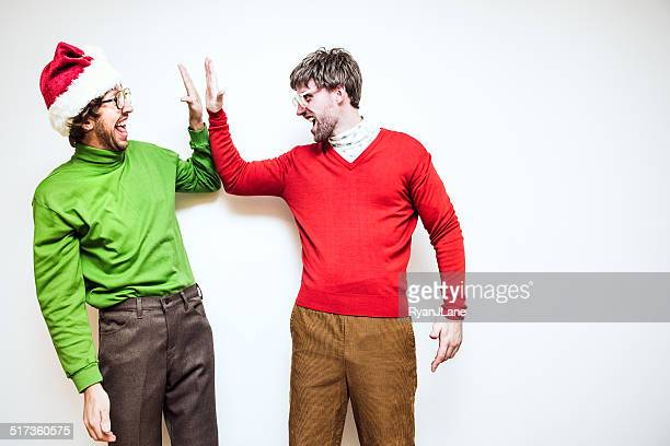 christmas nerd high five - ugly wallpaper stock photos and pictures