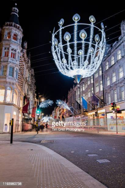 christmas, new bond street, london, uk. - tim grist stock pictures, royalty-free photos & images