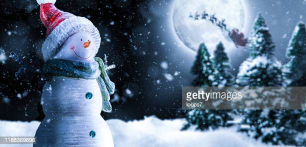christmas night with snowman, santa and moon - snowman stock pictures, royalty-free photos & images