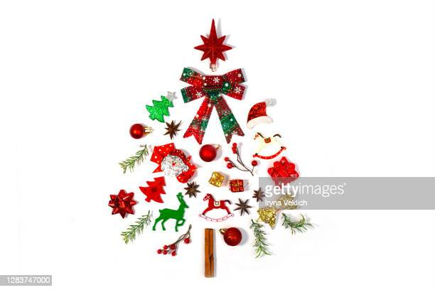 christmas objects laid out in the shape of a christmas tree. - hat stock pictures, royalty-free photos & images