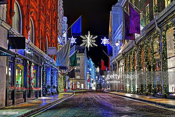 christmas on old bond street at night - anatoleya stock pictures, royalty-free photos & images
