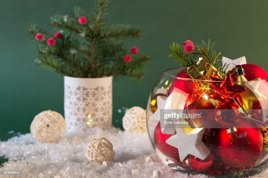 christmas or new year bright decoration in glass vase with candy canes on green background - How To Decorate Glass Vases For Christmas