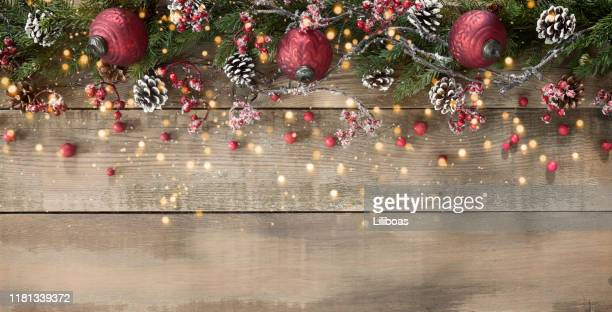 christmas ornament and garland background on wood - christmas wallpaper stock pictures, royalty-free photos & images