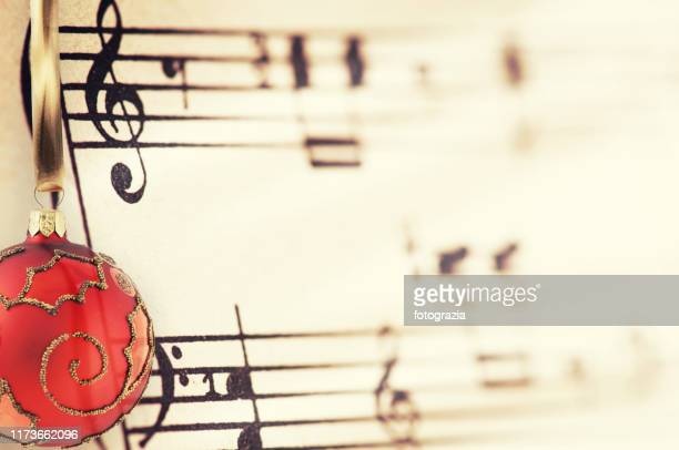 christmas ornament and sheet music - christmas music stock pictures, royalty-free photos & images