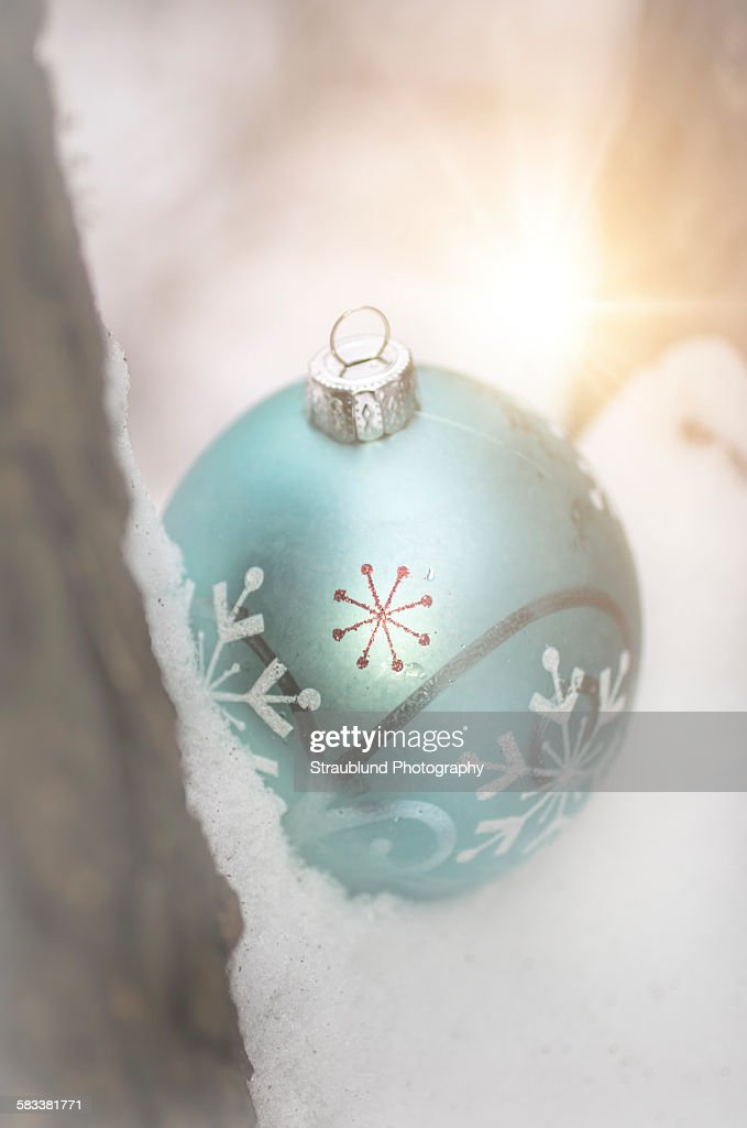 Christmas ornament in snow : Stock Photo