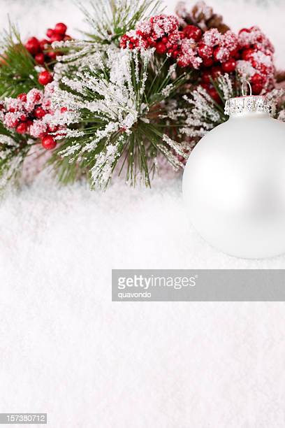 Christmas Ornament in Snowy Pine Branch and Holly, Copy Space