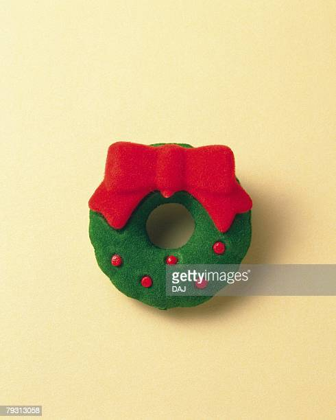 christmas ornament shaped wreath, front view, colored background - christmas background stock photos and pictures
