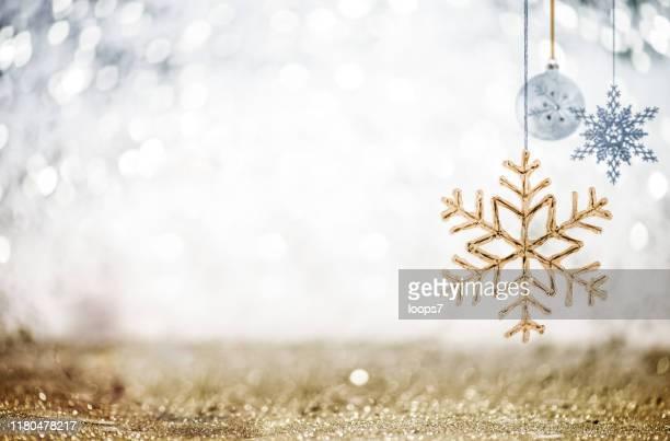 christmas ornaments against glittering defocused background - decorazione natalizia foto e immagini stock