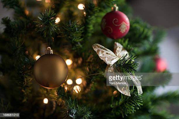Christmas ornaments and ribbon on tree