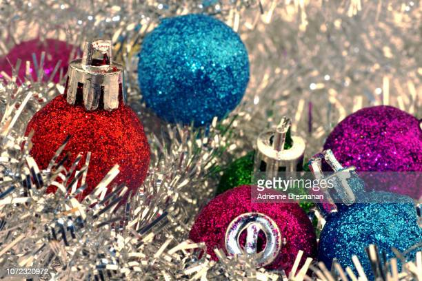 christmas ornaments and silver tinsel - tinsel stock pictures, royalty-free photos & images