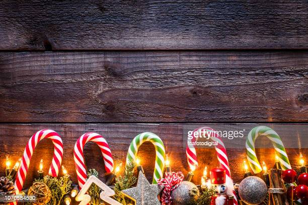 christmas ornaments background on rustic wooden table - candy cane stock pictures, royalty-free photos & images