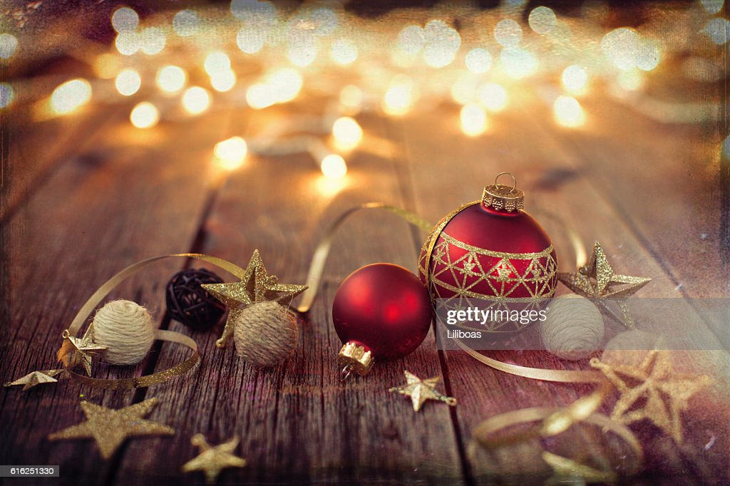 Christmas Ornaments Baubles Ribbon and Lights on Old Wood Background : Stock Photo
