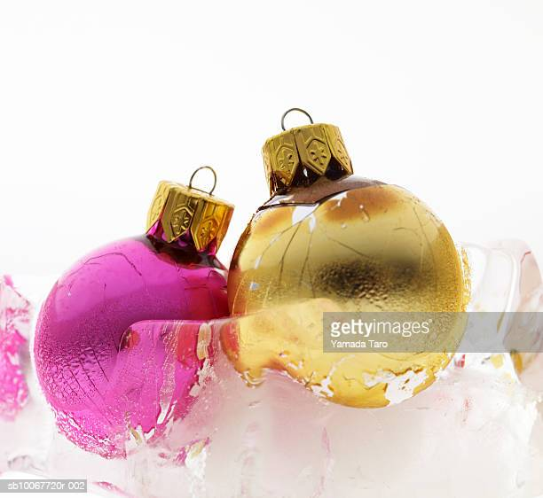 Christmas ornaments in block of ice, close-up
