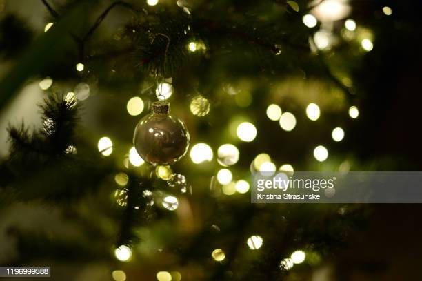 christmas ornaments in silver color on a christmas tree - kristina strasunske stock pictures, royalty-free photos & images
