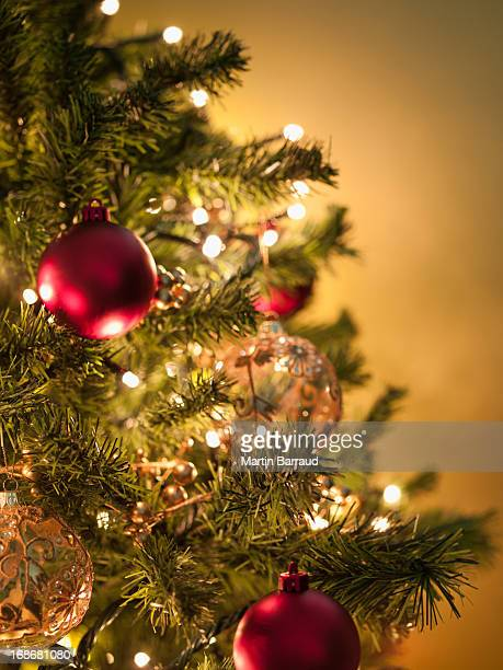 christmas ornaments on tree - christmas tree stock pictures, royalty-free photos & images