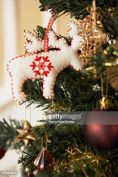christmas ornaments on tree - climat stock pictures, royalty-free photos & images