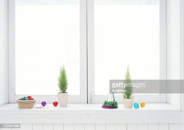 christmas ornaments on windowsill - erker stockfoto's en -beelden