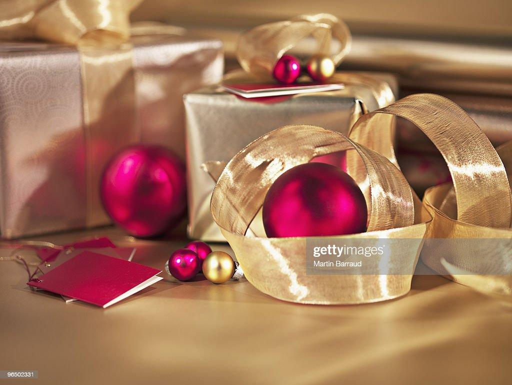 Christmas ornaments, ribbon and gifts : Stock Photo