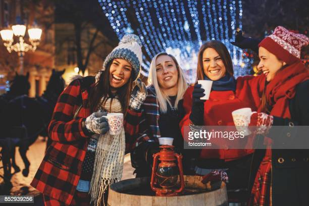 christmas parties are the best with friends - christmas market stock pictures, royalty-free photos & images