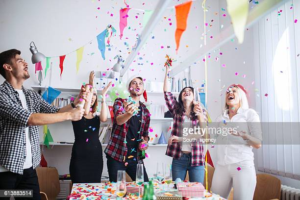 christmas party in office - work party stock pictures, royalty-free photos & images