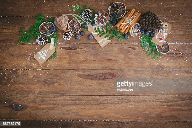 Christmas pine cones, pine branches, cinnamon sticks, dried oranges and tags