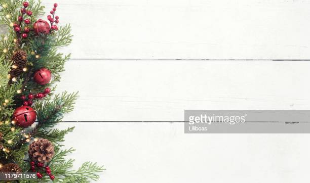 christmas pine garland border on an old white wood background - white wood stock pictures, royalty-free photos & images