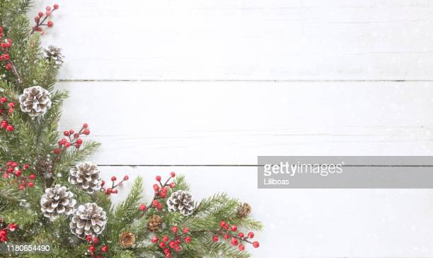 christmas pine garland border on an old white wood background - holiday stock pictures, royalty-free photos & images
