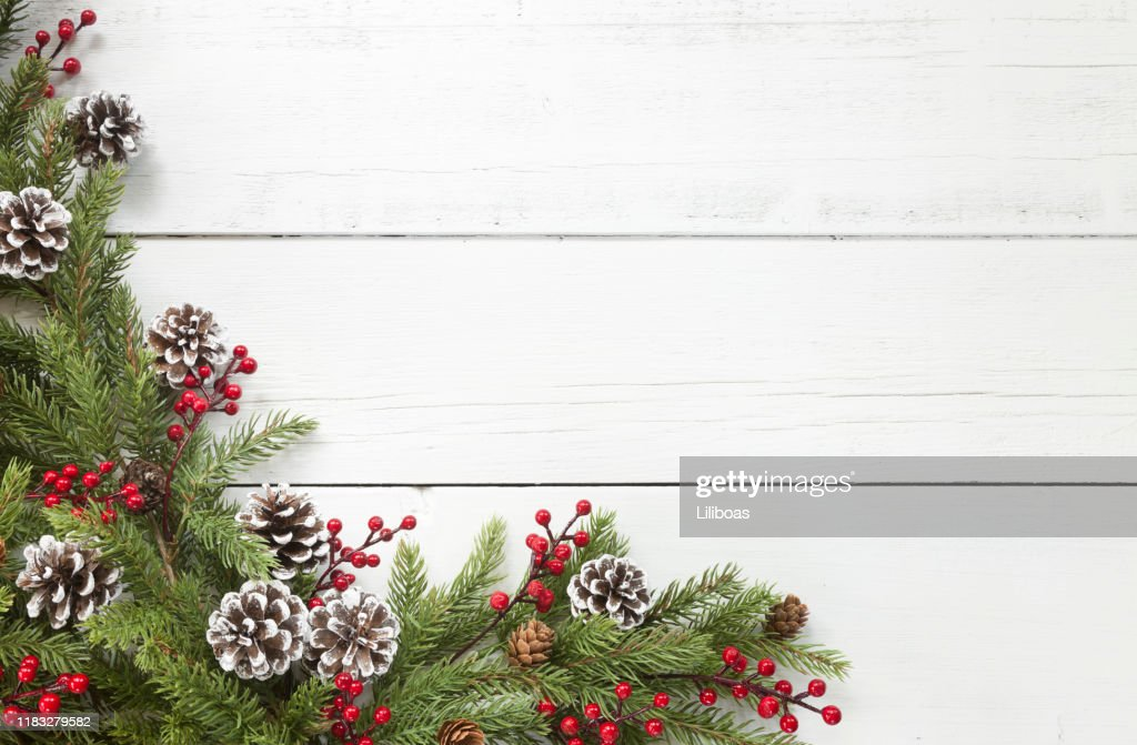 Christmas pine garland border on an old white wood background : Stock Photo