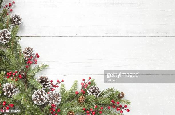 christmas pine garland border on an old white wood background - garland stock pictures, royalty-free photos & images
