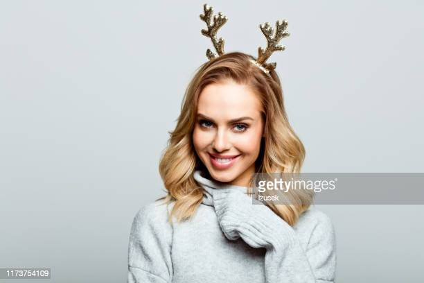 christmas portrait of beautiful woman, close up of face stock photo - christmas stock pictures, royalty-free photos & images