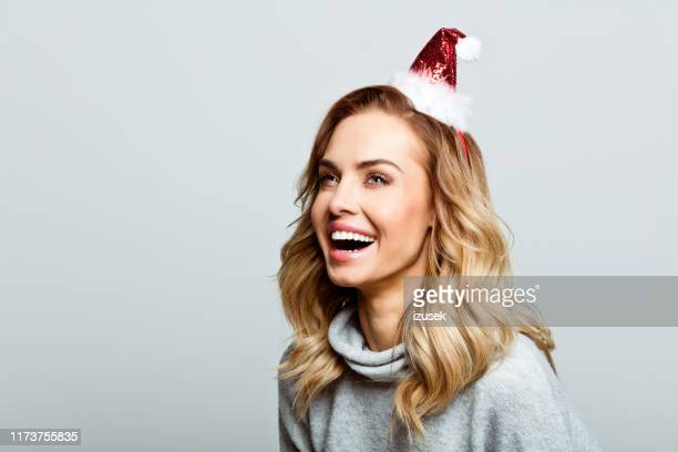 christmas portrait of excited beautiful woman, close up of face stock photo - santa face stock photos and pictures