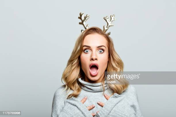 christmas portrait of surprised beautiful woman, close up of face stock photo - human face stock pictures, royalty-free photos & images