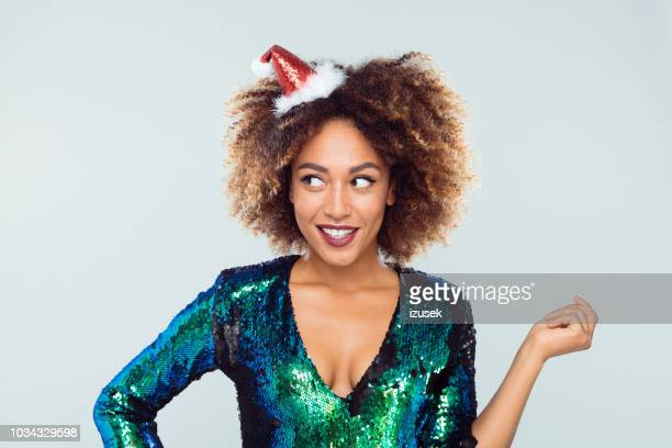 christmas portrait of surprised woman - sequin dress stock pictures, royalty-free photos & images