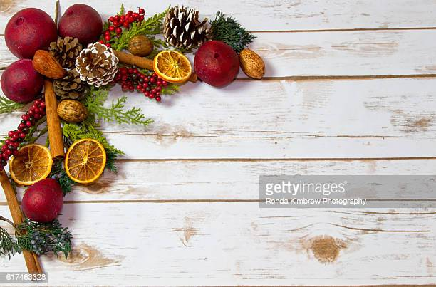 christmas potpourri on a white washed wood plank background - christmas garland stock pictures, royalty-free photos & images