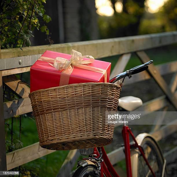 Christmas present in basket on bike.